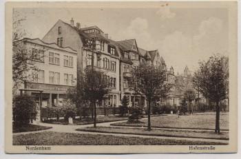 AK Nordenham Hafenstrasse mit Bäumen und Geschäft 1931 RAR