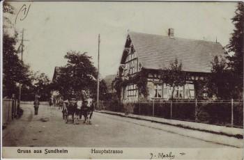 AK Gruss aus Sundheim Hauptstrasse mit Menschen bei Kehl 1920 RAR