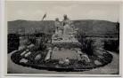 AK Foto Niederheimbach am Rhein Mutterdenkmal im Märchenhain mit Fahnen 1940