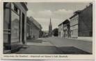 AK Heiligenhaus Bezirk Düsseldorf Hauptstraße mit Postamt u. kath. Pfarrkirche 1953