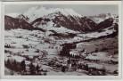 AK Foto Gstaad Saanen Ortsansicht im Winter BE Schweiz 1950