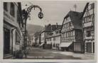AK Foto Miltenberg am Main Hauptstraße mit Gasthof Zum schwarzen Adler 1931