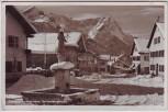 AK Foto Garmisch-Partenkirchen Sonnenbergstraße im Winter mit Brunnen 1954