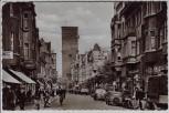 AK Foto Leverkusen Wiesdorf Hauptstraße viele Menschen Autos Geschäfte 1953