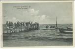 AK Ostseebad Grömitz in Holstein Abfahrt der Gäste Steg Menschen Boote 1913