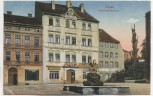 AK Zittau Schwanen-Brunnen mit Geschäften 1922