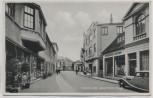 AK Foto Varel Adolf-Hitler-Straße mit Fahne Geschäften 1940 RAR